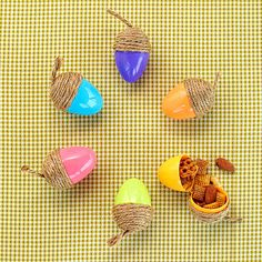 Go nuts! Make adorable acorn treat holders this fall. Not only are they great for sending in school lunches, but the easy fall craft is a thoughtful party favor or decoration, too. To make, simply hot-glue twine around the wide end of a plastic Easter egg, then fill with snacks, candy, or other fun treats.