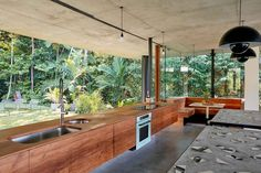 Robyn Boyd award-winning, modern house for sale in Cairns, Queensland. Planchonella House by Jesse Bennett Studio. Gravity Home, Australian Homes, Tropical Houses, Modern Tropical House, Residential Architecture, Tropical Architecture, House Architecture, Brutalist, Concrete Floors
