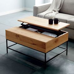 Home Lofted on airy steel legs, our Industrial Storage Coffee Table's top pops up to reveal a boatload of hidden storage