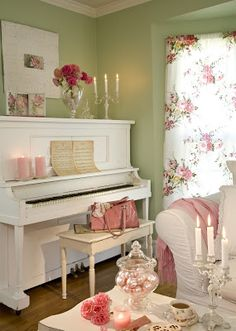 fresh green painted walls next to white piano and slipcovers, also love the floral curtain.