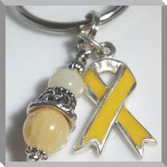 Yellow Awareness Ribbon and Pendant Keychain by Angelof2 on Etsy ~ Support Your Cause! Ribbon and Pendant hooked to a heavy duty key ring by a jump ring large enough to be able to add all your keys and store discount cards. Yellow represents: * Adoptive Parents * Amber Alerts (Missing Children) * Bladder Cancer * Endometriosis * General Symbol for Hope * Deployed Military * POW/MIA * Suicide Prevention * Spina Bifida * Hydrocephalus
