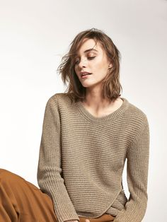 Knit sweater with front crossover detail. Straight cut, semi boatneck and long sleeves.