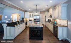 This gourmet kitchen is any chef's dream! The Travis, house design #1350.