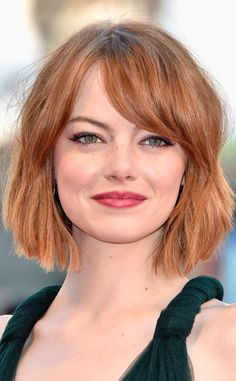 We're obsessed with Emma Stone's fiery hue. Because if you're going red, do it bold or just don't do it at all. (Click for more fall hair colors we love.)