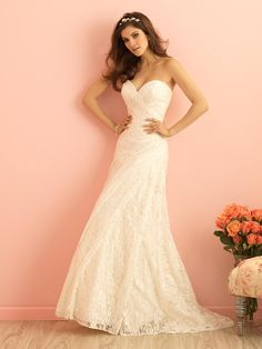 Mermaid wedding dress features sweetheart neckline on simple lace bodice. Ruched lace not only adds visual interest but creates a flattering silhouette in this strapless gown.