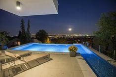 Swimming pool view by ARX Studio