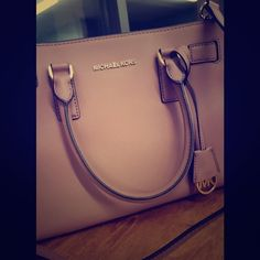 Michael Kors purse Perfect condition, no scratches or tears. Used only a few times. Dusty rose color, and cross body strap is included. Michael Kors Bags Totes