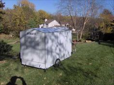 This is an amazing pop-up bike camper, with kitchen and bathroom capabilities.
