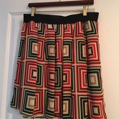 Vince Camuto flare skirt Cute, graphic, A-Line Vince Camuto skirt. Falls above the knee. Fully lined. Can be styled with black tights and boots in winter or bare legs and strappy heels or flats in summer. Looks great dressed up or down. RN# 51323 Vince Camuto Skirts A-Line or Full
