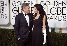 George and Amal Clooney arrive at the 72nd Golden Globe Awards in Beverly Hills: Actor George Clooney and wife Amal Clooney.