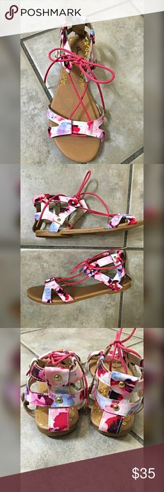 NWT multi color floral lace up sandals! Gorgeous colors in fuchsia- light pink - plum and blue! Easy - comfortable pop of color! Love these Shoes Sandals