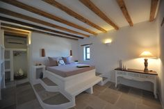 Built bed and night tables, decorative beams and window lintels.