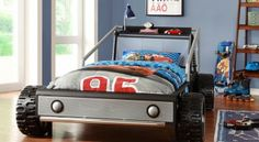 This fun twin bed has molded tires and display shelf.