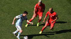 Lionel Messi of Argentina controls the ball against Valon Behrami of Switzerland