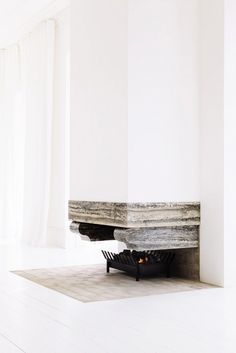 Modern fireplace with stone detail.