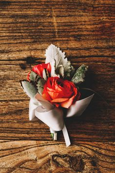 orange ranunculus boutonniere, photo by Two Pair Photography http://ruffledblog.com/the-plant-at-kyle-wedding #boutonnieres #grooms #flowers