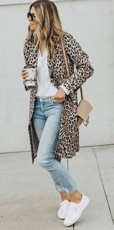 #fall #outfits women's brown-and-black leopard spotted coat; white button up shirt ; blue jeans; pair of white low top sneakers