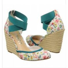REPORT, ANTONELLA WEDGE PUMP BRAND NEW Brand & Style - Report Antonella Width - Medium (B, M) True Color - White Floral Upper Material - Textile Outsole Material - Man-Made Heel Height - 4 Inches  Style Description - Color your closet with the lighthearted Report Antonella wedges. These wedges come in fabric, printed in either polkadots or a floral design. Criss-crossing elastic straps hug your ankle. The jute-wrapped wedge heel only adds to the playful, warm weather appeal. Report Shoes…