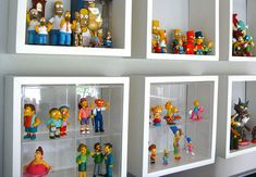 great way to display action figures/figurines! so clean and organized!