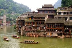 Boats and wooden houses at Phoenix Town - one of the four most attractive small towns in China, next to Tuojiang Amazing Places On Earth, Beautiful Places In The World, Beautiful Places To Visit, Places To See, Travel Around The World, Around The Worlds, Tb Joshua, Beaux Villages, Vacation Places
