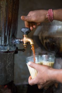 A chai wallah, tea seller, pours hot chai, a fragrantly spiced black tea with milk. Scenes from India: North | SAVEUR
