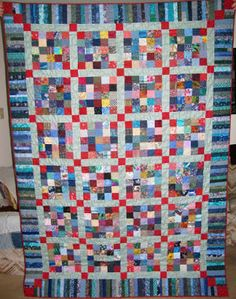 Quilt Border Idea: The corner squares nicely match both piano key border and continue the red squares, that move across the quilt. This 25 Patch (with red corners) Scrappy Quilt was made by Louisa Robertson from Lou Quilts