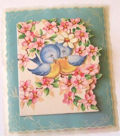 Vintage die-cut greeting card with bluebirds and blossoms.
