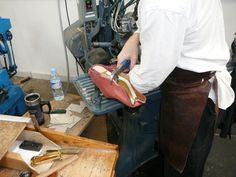 "A tour of Northampton - Edward Green Factory - STEP 10 ""Lasting"" - Hand lasting or stretching the upper of a shoe around the last with a lasting pincher. Pinch and pull the leather tightly around the last starting with the tip of the toe and nail the edge into the bottom of the last to secure, like one upholsters a cushion evenly pinching one side then the other splitting the spaces between the nails smoothing out any bumps and wrinkles. A machine can stretch the toe much tighter than the…"