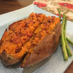 1. Preheat oven to 375 and cook the sweet potato for an hour. 2. Remove potato and slice in half 3. Remove the filling and mix it with a tsp of nutmeg and a tsp of cinnamon 4. Put potato back in the oven at 375 for 12 minutes 5. Remove potato, and I personally topped it with left over bacon from earlier this morning and of course some ghee!
