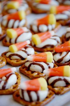 12 Days of Halloween: Baking Treats ------- Halloween Pretzel/Chocolate Snack: 350 deg. put waffle square pretzels on parchment lined baking sheet; top w/ unwrapped Hug or Kiss; bake press candy corn into each soft chocolate; Halloween Snacks, Halloween Make, Halloween Baking, Halloween Favors, Group Halloween, Halloween Birthday, Halloween Costumes, Holiday Desserts, Gourmet