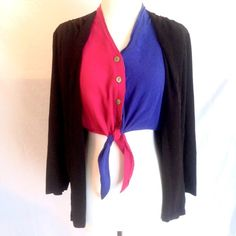 """Vintage Colorblock Layered Crop Top I am totally in love with this piece! True vintage from the late 80's early 90's era. Bright pink and blue button up tie front cropped blouse with attached lightweight black blazer. So awesome, effortless, and unique! Looks fantastic paired with high waisted shorts for an urban laid back style. Made in USA. By Christine David. Size Small. 65% acetate 35% rayon. Chest measures 36"""". Length 13-27"""". Sleeve 24"""". Good pre-owned condition with no holes, rips, or…"""