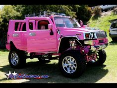Pink Hummer H2 with miniature poodle on the passenger seat.