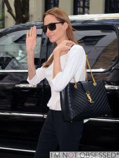 Angelina black pants, white top, YSL bag