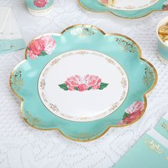 Create a tea party to remember with the exquisite items in our Eternal Rose collection, including these stunning scalloped edge plates. The design on the plates recalls classic vintage crockery, with its gold edging and floral motifs. A pretty colour palette of turquoise, white and pink offers the perfect background to a classic high tea of cake, scones and sandwiches.