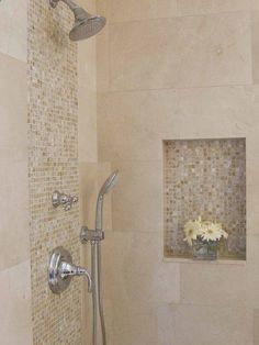 Large travertine tiles, with small accent glass or mosaic tiles