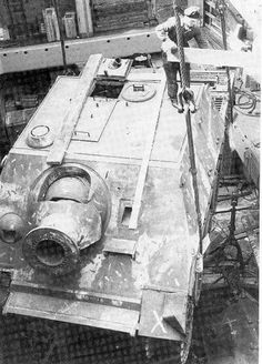 A great overhead view of a Sturmtiger being loaded into a cargo ship hold