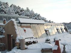 A rare winter view of an earthship-style underground house