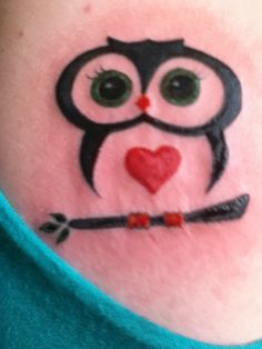 small owl tattoo, but blue eyes and no branch and small enough to be a charm.