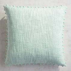Here's a new favorite solid-color option. Our basketweave design with a pop of pompoms cozies up to your patterned pillows nicely, providing texture and balance. Also, it includes a hidden zipper for easy access to a supportive poly insert for long-lasting comfort.