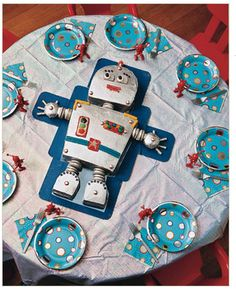 Robot Cake... I love the look of the table with the robot in the middle. I like the colors too silver and blue with a touch of red.