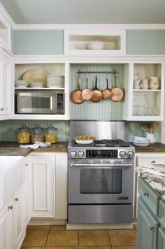 Love the copper pans over the stove...'course, we'd have to buy copper pans...