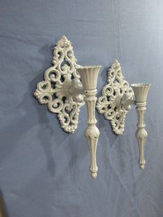 Hey, I found this really awesome Etsy listing at https://www.etsy.com/listing/386133984/upcycled-cast-iron-candle-sconces-set-of