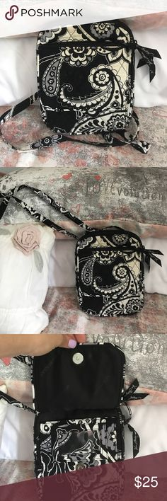 Vera Bradley Crossbody In pretty good condition. The white is starting to darken, but i think if this is thrown in the wash it'll come out perfect. Some dark spots are also on the white. Other than that this bag has a lot of life left to it! Vera Bradley Bags Crossbody Bags
