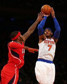 JANUARY 27: Carmelo Anthony #7 of the New York Knicks takes a shot as Josh Smith #5 of the Atlanta Hawks defends