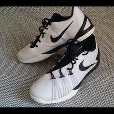 Nike Hyperchase 2015 Never worn. Comes in original box. Size 14, runs a bit small. Nike Shoes Athletic Shoes