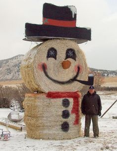 awesome snowman made of round bales of hay!