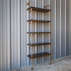 Industrial shelving can be chic and with the copper finish work the pipe shelving has a great impact. Everyone has room to add an industrial bookshelf to their decor. Think of all the books or records