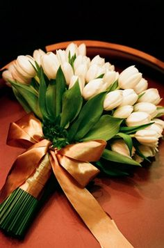 white tulips wedding bouquett / http://www.himisspuff.com/white-tulip-wedding-ideas-for-spring-weddings/2/