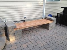 Solid paving stone bench with seat bars. Solid paving stone bench with seat bars. Modern Backyard, Backyard Pergola, Paver Fire Pit, Cinder Block Garden, Fire Pit Landscaping, Outdoor Stone, Stone Bench, Brick Patios, Paving Stones