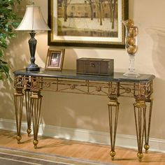 Console Table - Metalworks - 1650025. Console Table - Metalworks - 1650025 Metal frame and carved resin components. Black fossil stone veneer top with snakeskin fossil stone veneer and brass inset. Product Specifications Dimensions 60 W x 21 D x 32 H (inches) F.. . See More Console Tables at http://www.ourgreatshop.com/Console-Tables-C694.aspx